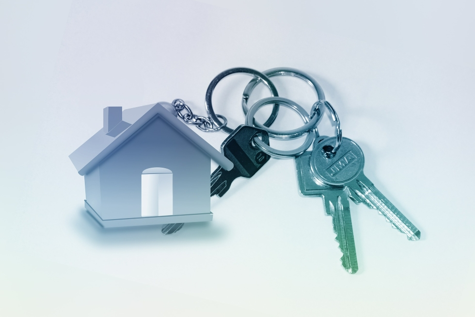 Photo of house on a key ring to represent residential property
