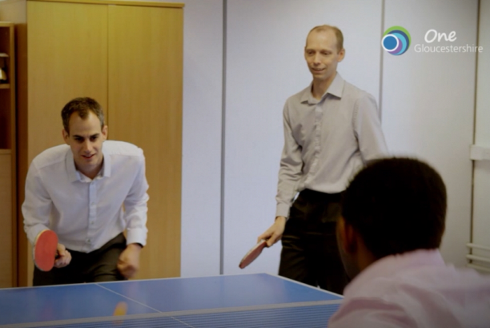Photo of staff at Randall & Payne playing table tennis in their lunch hour