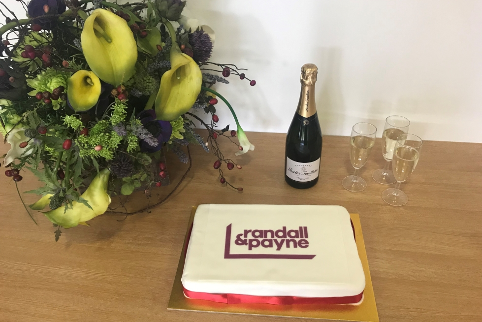 Cake and Champagne celebrating a year at Randall & Payne
